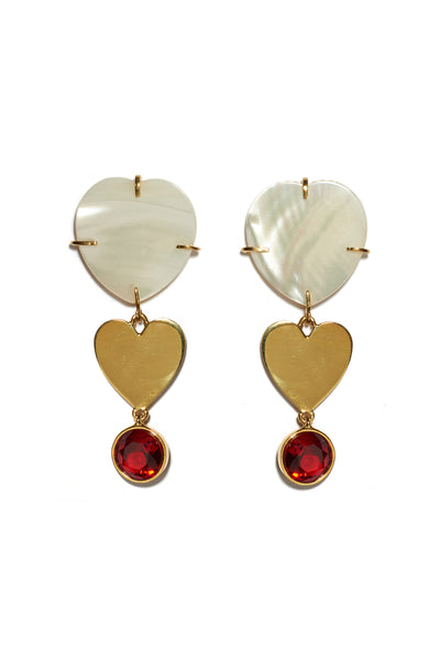 Thumbnail of Ace Of Hearts Earrings. Mother-of-pearl hearts with gold-plated heart and red faceted glass hanging charms. Dainty and whimsical earrings suitable for everyday wear.