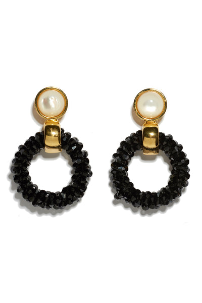 Thumbnail of Brancusi Hoops In Black. These gold-plated brass and black cut glass beaded earrings with mother-of-pearl tops are a modern sculptural update on the classic hoop silhouette.