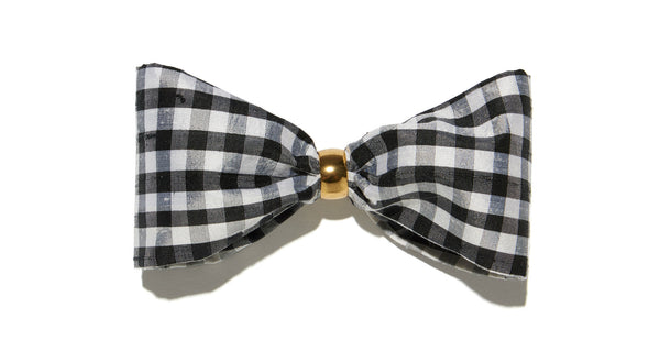 Full view of Bow In Gingham. The sweetest way to raise the style profile of your everyday ponytail is with our new barrette with black and white gingham silk shantung bow.