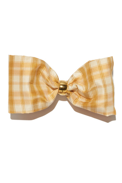 Thumbnail of Bow In Pale Tartan. The sweetest way to raise the style profile of your everyday ponytail is with our gold barrette with light yellow plaid silk taffetta bow.