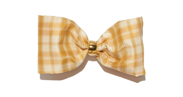 Full view of Bow In Pale Tartan. The sweetest way to raise the style profile of your everyday ponytail is with our gold barrette with light yellow plaid silk taffetta bow.