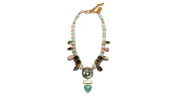 Full view of What's Old Is New Necklace. Prepare yourself for compliments; this mixed material necklace is a true showstopper. Light aqua and pink morganite, quartz and gold-plated beads with pink opal, black agate, labradorite, jade, green quartz and obsidian semiprecious charms with abalone shell, mother-of-pearl and green quartz heart pendant.
