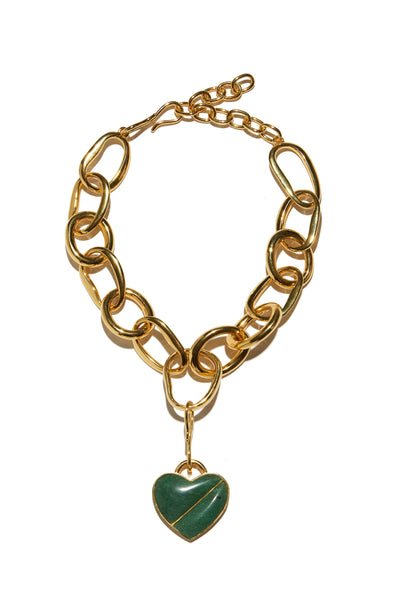 Thumbnail of Porto Necklace In Green Heart.  With its large links and detachable heart pendant, the Porto Necklace makes for a perfect subtle statement. Gold-plated brass chain with green quartz semiprecious stone heart.