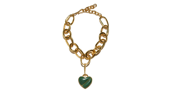 Full view of Porto Necklace In Green Heart.  With its large links and detachable heart pendant, the Porto Necklace makes for a perfect subtle statement. Gold-plated brass chain with green quartz semiprecious stone heart.