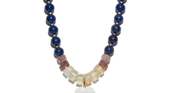 Middle bead detail of Louis Necklace. Whether paired with a strapless dress or denim shirt, this heart necklace is simply too pretty to take off. Lapis, strawberry quartz and citrine beads with mother-of-pearl heart and black agate drop pendant.