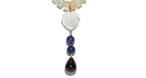 Bottom pendant drop detail of Louis Necklace. Whether paired with a strapless dress or denim shirt, this heart necklace is simply too pretty to take off. Lapis, strawberry quartz and citrine beads with mother-of-pearl heart and black agate drop pendant.
