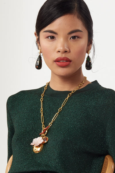 Thumbnail of model wearing Windsor Charm Necklace. Light up the room in this flattering, rosy-hued chain link necklace. Gold-plated brass with pearl and semiprecious stone pendant, carved pink mother-of-pearl flower, faceted glass stone charm and enamel toggle closure.