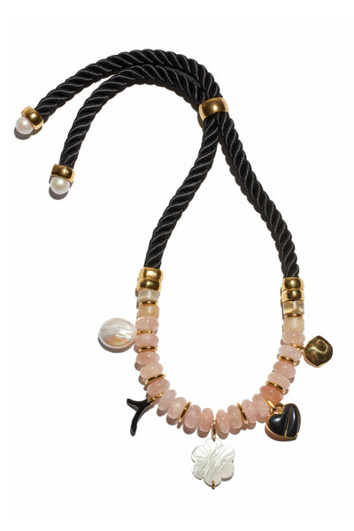 Thumbnail of Memento Necklace. Quite possibly the prettiest way to make a statement. Adjustable twist cord and light pink morganite beaded necklace with pearl, black agate, enameled and gold-plated heart and flower charms.