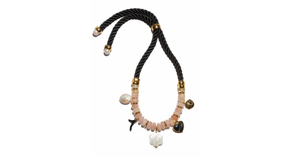 Full view of Memento Necklace. Quite possibly the prettiest way to make a statement. Adjustable twist cord and light pink morganite beaded necklace with pearl, black agate, enameled and gold-plated heart and flower charms.