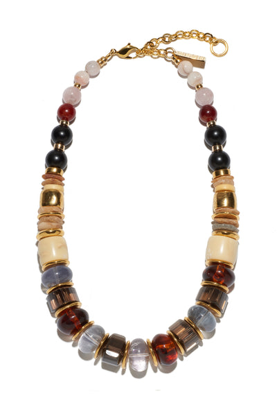 Thumbnail of Landmark Necklace. We love how our classic silhouette is easy to style with your favorite t-shirt or dressed up for a night out. Beautiful single strand necklace with morganite, black agate, quartz, acrylic, coral, fluorite and gold-plated beads.