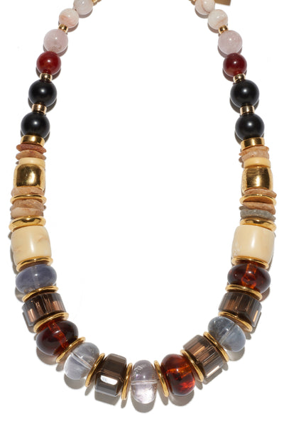 Thumbnail close-up of Landmark Necklace. We love how our classic silhouette is easy to style with your favorite t-shirt or dressed up for a night out. Beautiful single strand necklace with morganite, black agate, quartz, acrylic, coral, fluorite and gold-plated beads.