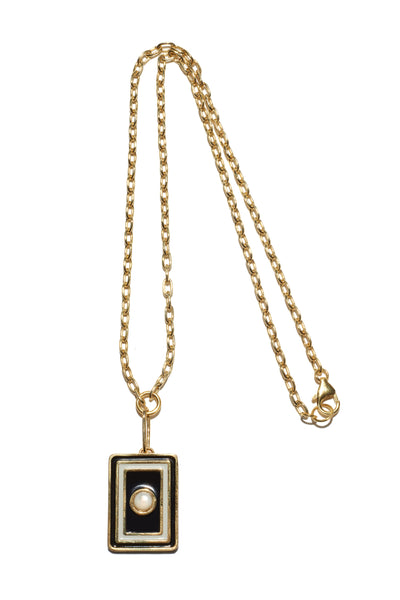 "Thumbnail of Tarot Necklace In Black And White. A wear-everyday layering piece with an heirloom feel. Your good fortune is assured with the gold-plated vermeil chain necklace and brass ""frame"" pendant in black and white enamel and mother-of-pearl cabochon."