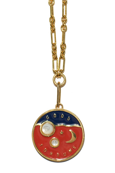 "Thumbnail close-up of Fortune Necklace In Lucky Red. A new wear-everyday layering piece with an heirloom feel. Gold-plated vermeil chain necklace with gold-plated brass ""Good Fortune"" poker chip pendant with red and blue enamel and mother-of-pearl cabochons."