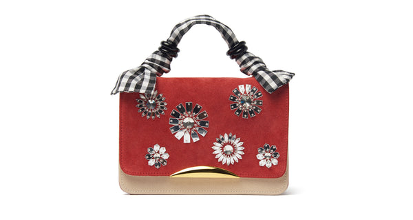 "Full view of Beatrice Purse In Al Fresco. Your unique statement bag is here in cherry calf suede and nude saffiano leather. This purse has a hand-sewn crystal bloom embroidered flap, gold-plated ""arc"" hardware and black and white gingham silk fabric top handle."