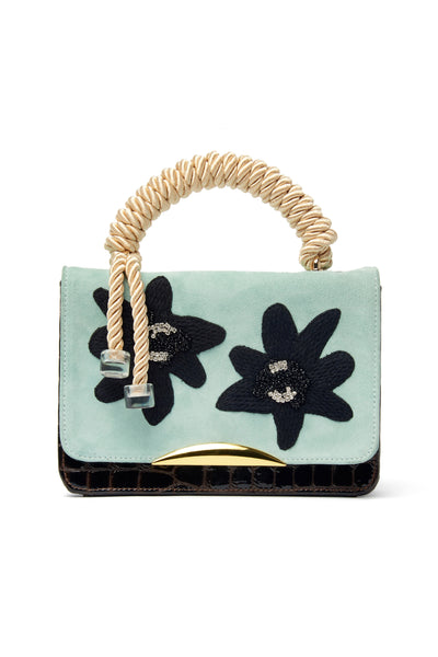 "Thumbnail of Beatrice Purse In Matisse Floral. Your unique statement bag is here in light blue calf suede and chocolate embossed patent leather. This purse features a black embroidered, crystal and beaded floral flap, gold-plated ""arc"" hardware and cream rope top handle."