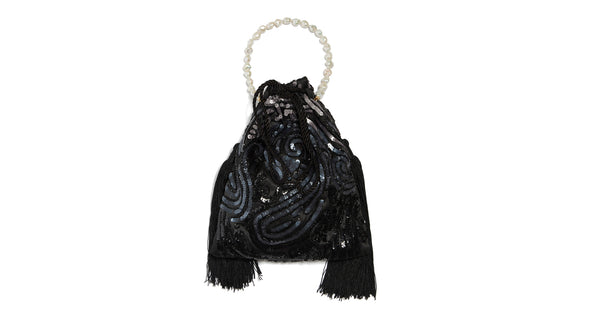 Full view of Gala Wristlet In Deco Sequins. Be ready to take on any event and effortlessly turn heads with our dramatic black sequined drawstring purse, featuring oversized black tassel fringe and a freshwater pearl wristlet.