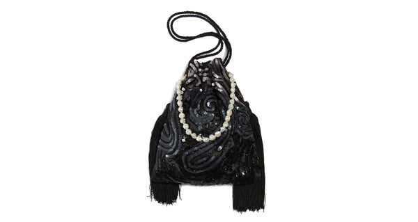 Alternate full view of Gala Wristlet In Deco Sequins. Be ready to take on any event and effortlessly turn heads with our dramatic black sequined drawstring purse, featuring oversized black tassel fringe and a freshwater pearl wristlet.