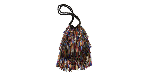 Full view of Gala Wristlet In Disco Fringe. Be ready to take on any event and effortlessly turn heads with our unique drawstring purse, featuring multicolor hand-sewn bugle beads and black twist cord wristlet.