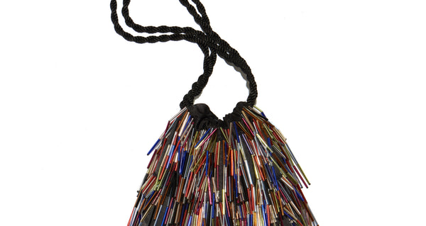 Top handle detail of Gala Wristlet In Disco Fringe. Be ready to take on any event and effortlessly turn heads with our unique drawstring purse, featuring multicolor hand-sewn bugle beads and black twist cord wristlet.