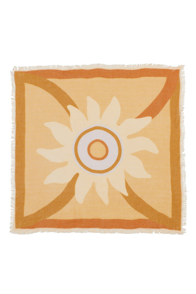 Thumbnail of Neck Scarf in Bohemian Sun. Our square wool neck scarf  will keep you cozy and  comes with unique gold-plated kidney closure for maximum styling opportunities. Light tangerine with pale yellow and periwinkle graphic sunshine print and fringed edges.