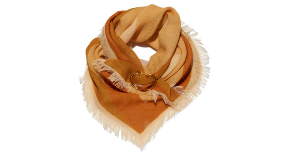 Wrapped view of Neck Scarf in Bohemian Sun. Our square wool neck scarf  will keep you cozy and  comes with unique gold-plated kidney closure for maximum styling opportunities. Light tangerine with pale yellow and periwinkle graphic sunshine print and fringed edges.