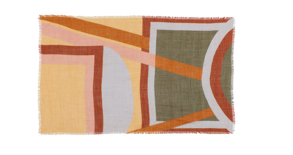 Full view of Large Graphic Stella Scarf. Our oversized rectangular 100% wool scarf will keep you cozy and can be styled in so many ways. With statement-making peach, periwinkle, rust and olive multicolor graphic print and fringed edges.
