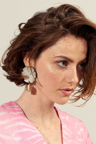 Thumbnail of model wearing the Pearl Blossom Earrings. Organic meets opulent. Wear the best ...