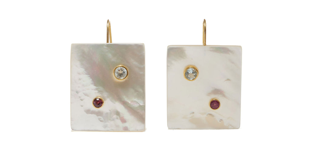 Full view of Domino Earrings. The domino effect: put on these sophisticated drop earrings and instantly elevate the rest of your outfit. In shiny mother-of-pearl rectangles set with semiprecious faceted blue topaz and garnet stones.
