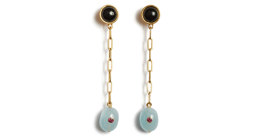 Full view of Moroccan Modern Earrings. Be an early adopter in next season's gracefully stylish pair of long gold-plated chain earrings. With shiny black onyx tops and hanging aquamarine drops inlaid with semiprecious pink rhodolite stones.