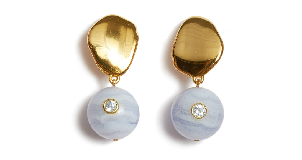Full view of Lalla Earrings. We la la love these lightweight gold-plated petal top earrings for everyday wear.  Featuring cool blue lace agate hanging beads set with faceted semiprecious blue topaz. Make it a match with our Lalla Necklace.