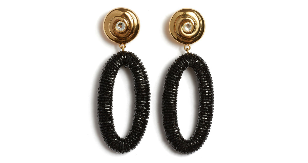 "Full view of Allure Earrings. Go for full glamor in this poised pair of ebony beaded earrings with gold ""nautilus"" tops and inset crystal detail. They're the perfect accessory for office parties and black-tie events alike."