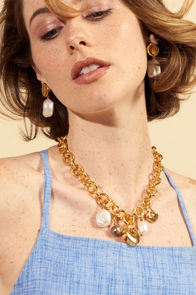 Thumbnail of model wearing the Medina Heart Necklace. Show off both your tough and tender si...