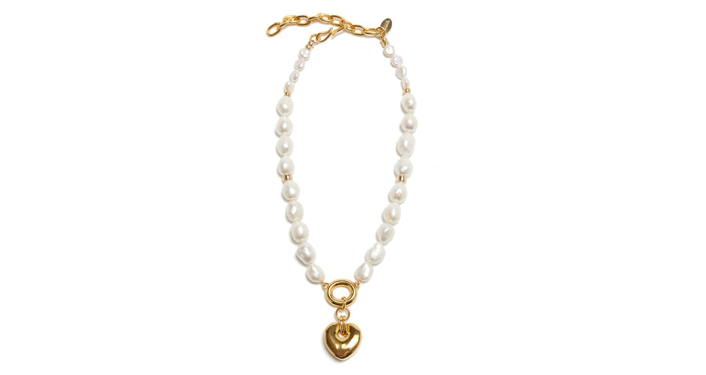Full view of Heartbreak Necklace. The heart motif is perennially beloved around here, and we think this iteration is pretty perfect. We've paired a classic pearl single-strand necklace with gold-plated heart pendant for a look you'll love for years to come.