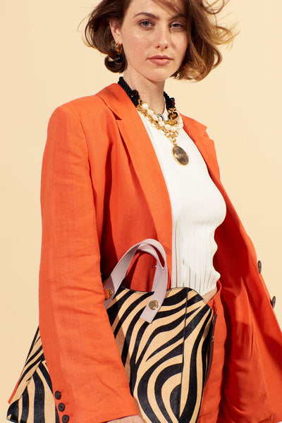 Thumbnail of model carrying the Friday Shopper Bag In Zebra. Talk about animal magnetism! Ou...