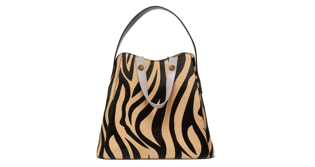 Full view of Friday Shopper Bag In Zebra. Talk about animal magnetism! Our black and tan zeb...