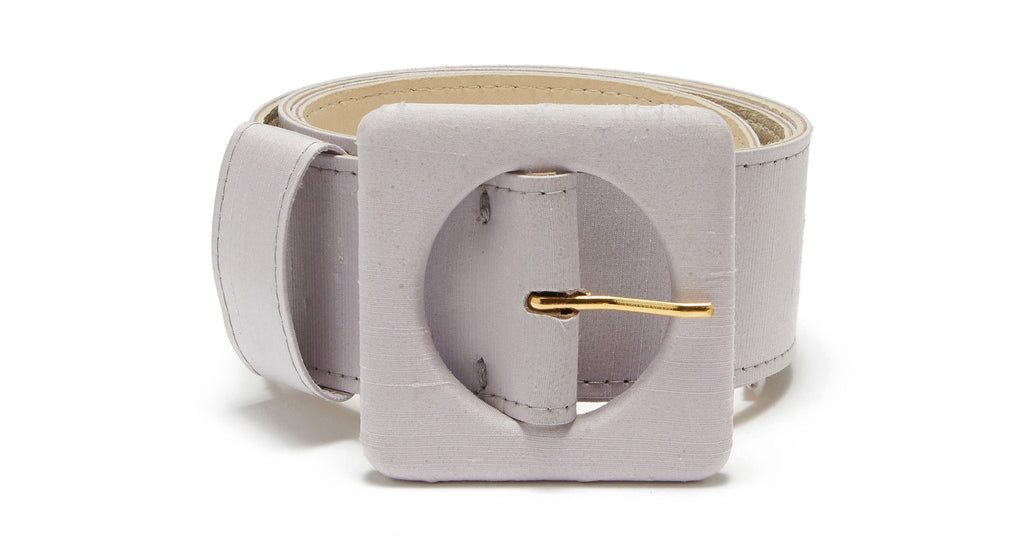 Full view of Agnes Belt In Lavender Silk. Our favorite wide belt silhouette got a makeover in a soft pastel shade of lavender silk. With signature oversized square buckle.