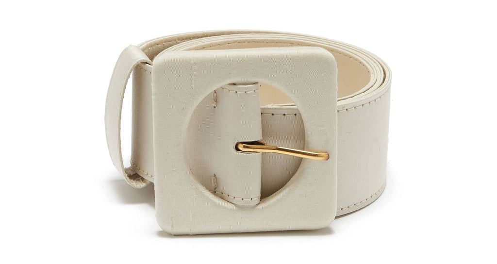 Full view of Agnes Belt In Cream Silk. Our favorite wide belt silhouette got a makeover in dreamy cream-coloured silk. With signature oversized square buckle.