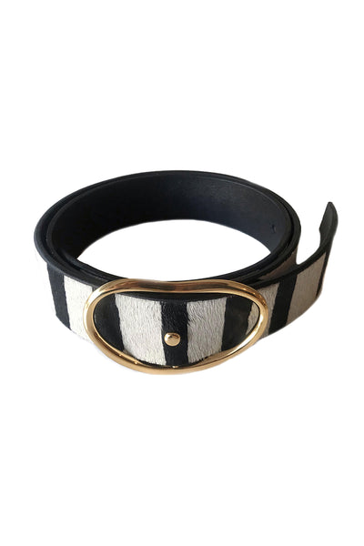 Thumbnail close-up of Wide Georgia Belt In Zebra. Earn your style stripes in our wide width belt in chic black and white animal-print, with signature kidney-shaped gold buckle.