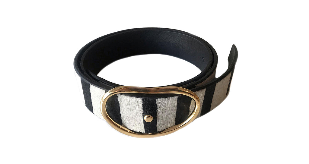 Full view of Wide Georgia Belt In Zebra. Earn your style stripes in our wide width belt in chic black and white animal-print, with signature kidney-shaped gold buckle.