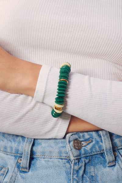 Thumbnail of model wearing the Candy Bracelet in Hunter. Perfect stacked or worn on its own,...