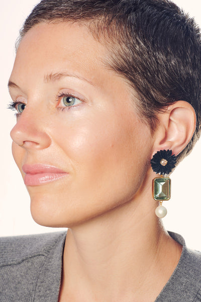 Thumbnail of model in the Sea Flower Earrings. Add a bloom of brilliance to your upcoming ho...