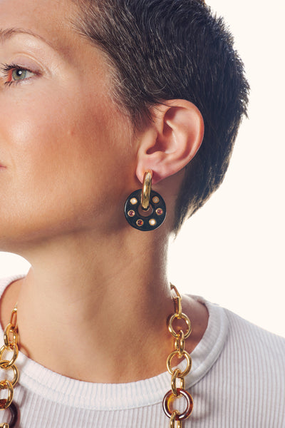 Thumbnail of model wearing the Arcade Earrings in Onyx. Game on! This lively pair of gold-pl...
