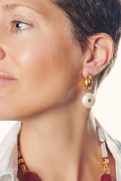 Thumbnail of model wearing the Circa Earrings. No time like the present to gift yourself a l...