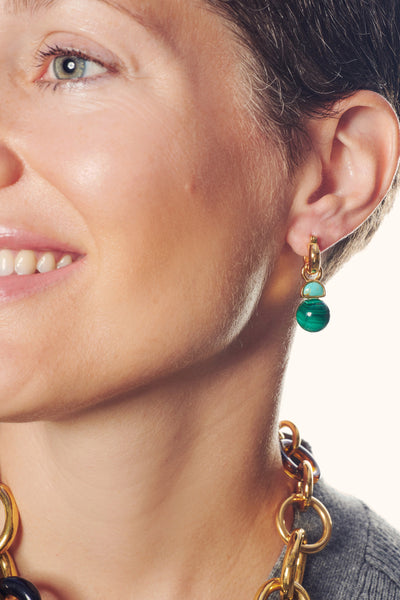 Thumbnail of model in the Juniper Earrings. Talk about a delicate situation. Indulge in our ...