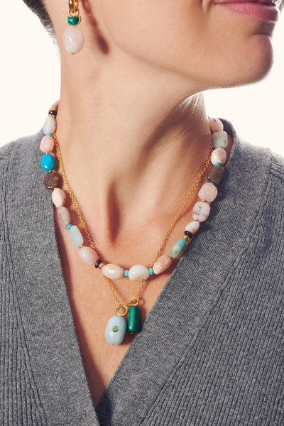 Thumbnail of model in the Heroine Necklace. This single strand stunner is made with turquois...