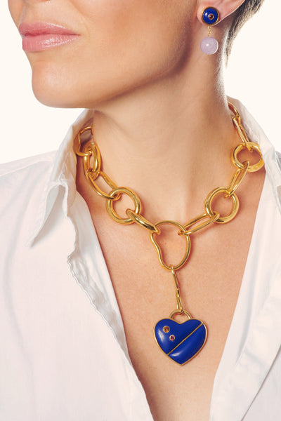 Thumbnail of model in the Porto Necklace in Lapis Heart. With its oversized gold links and d...