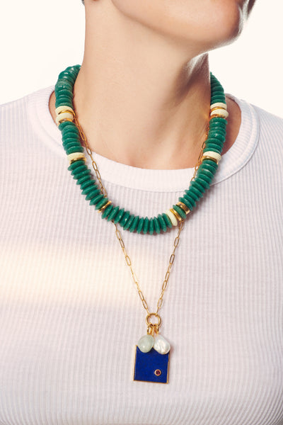 Thumbnail of model in the Laguna Necklace in Hunter. Back again in a brand new colorway, our...