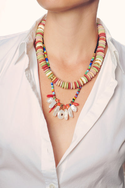 Thumbnail of model wearing the Isola Necklace in Rainbow. Our easy-to-wear Isola Necklace ha...