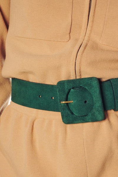 Thumbnail of model in the Agnes Belt In Emerald Suede. Give the green light to our wide silh...