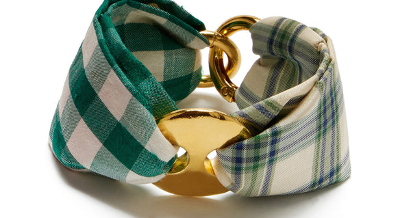 Close-up of Jane Bracelet In Green Plaid. Bring a little softness to your stack with the green plaid & gingham two-tone silk fabric bracelet. Gold-plated cinch and clasp hardware anchors the easy new silhouette that we can't wait to wear with everything.